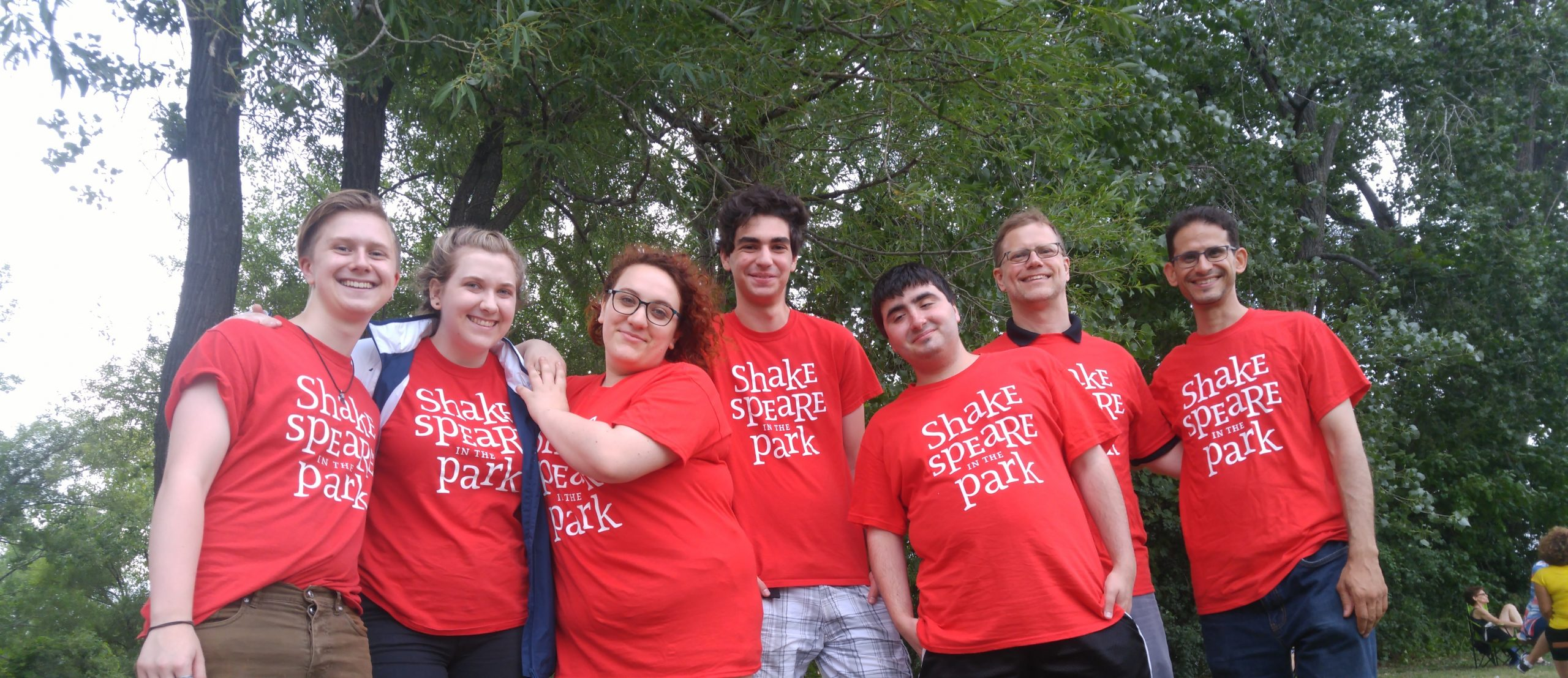 8 volunteers with the red repercussion theatre tshirts from 2018